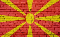 Flag of Macedonia painted on brick wall, background texture Stock Photos