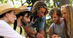 A group of hipster friends pointing maps Stock Footage