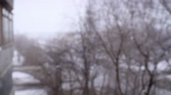 On snow-covered the street during a snowfall in slowmotion. Changes focus from Stock Footage