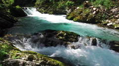 4K. Wild Radovna river flows in Vintgar Gorge. Clean blue water. Stock Footage