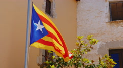 Catalan flag in the background of an old building Stock Footage