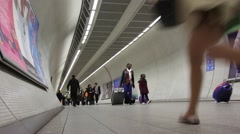 Passengers walk through tunnel in Kings Cross Underground Station Stock Footage