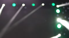 Spotlight strike through the darkness on stage. Stage lights. Several projectors Stock Footage