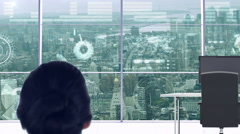 Businesswoman in office with futuristic city background Stock Footage