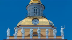 Upper part with clock of the tower of the Admiralty building timelapse in St - stock footage