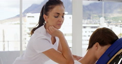 Therapist massaging the back of her patient Stock Footage