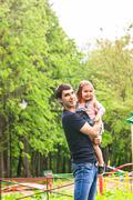 father with daughter in summer park - stock photo