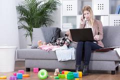 Desperate trials to combine work with motherhood - stock photo