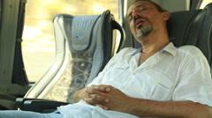 Man sleeping in bus 4 Stock Footage