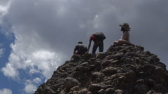 Three children enjoy the view from a small conglomerate peak. Stock Footage