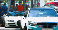 Tourists look at luxury cars near Beverly Wilshire Hotel in Los Angeles, 4K Stock Footage