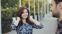 Girl straightens her hair and look to her boyfriend Stock Footage