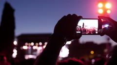Hands recording video with smart phones at music concert - stock footage