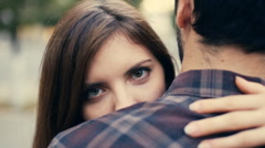 Girl's head on man's shoulder look into camera Stock Footage