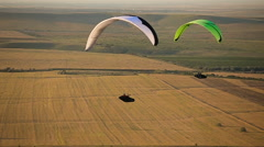 Paraglider in the sky over the steppe - stock footage