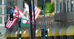 Flags waving at Beverly Wilshire Hotel landmark in Los Angeles 4K RAW Stock Footage