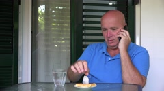 Man talking business on mobile phone making conversation during breakfast time. Stock Footage