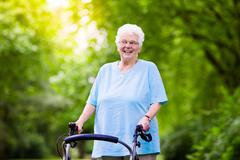 Senior lady with a walker - stock photo