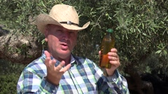 Farmer tv interview recommend an explain about best quality of olive oil. Stock Footage