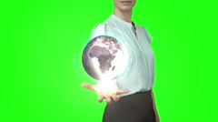 Businesswoman with globe animation in front of green screen Stock Footage