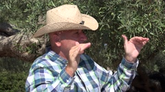 Olive tree farm owner explain audience about food industry business opportunity. Stock Footage