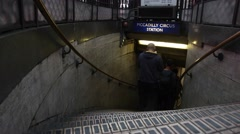 Passengers enter the Piccadilly Circus underground station entrance in London Stock Footage