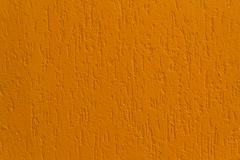 Bright orange stucco wall. Backgrounds and textures Stock Photos