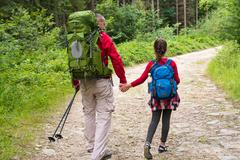 Father and doughter in mountains Stock Photos