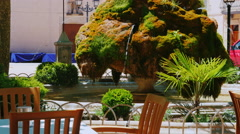 Unusual fountain - stone covered with moss. From stone water flows. Spain Stock Footage