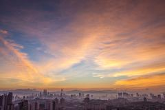 Kuala Lumpur cityscape at dawn with colorful cloudy sky Stock Photos