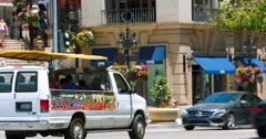 Sightseeing tourist bus crosses Rodeo Drive in Beverly Hills in Los Angeles 4K Stock Footage