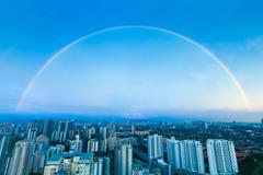 A complete double rainbow arch over Kuala Lumpur city - stock photo