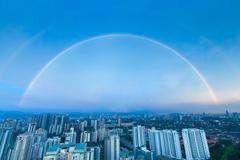 A complete double rainbow arch over Kuala Lumpur city Stock Photos