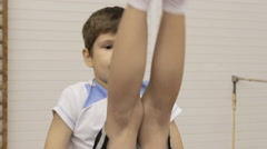 Young gymnast learn to perform gymnastic exercises Stock Footage