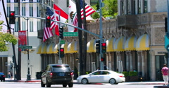 Traffic near Beverly Wilshire Hotel landmark in Los Angeles, California 4K RAW Stock Footage