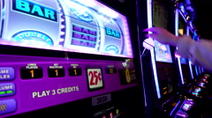 Close up woman playing slot machine inside Hard Rock Casino Stock Footage