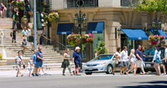 Tourists cross Rodeo Drive near Tiffany shop in Beverly Hills in Los Angeles 4K Stock Footage