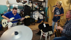 Singer woman and band, drummer, guitarist. Rehearsal before concert. Stock Footage