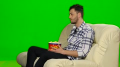 Man watching TV and smiling. Green screen Stock Footage