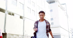 Man walking towards the camera and smiling Stock Footage