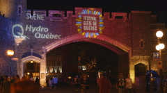 Festival d'ete logo projected on historic stone gate. Quebec City. Stock Footage