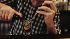 Bartender making a cocktail at the bar, close up Stock Footage