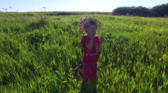 Girl child walks on a meadow. - stock footage