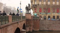 People walking on Anichkov bridge in Saint Petersburg in winter Stock Footage