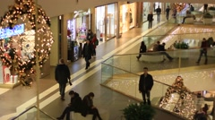 People in modern decorated shopping mall Stock Footage