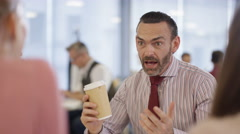 4K Portrait happy professional man drinking coffee in office breakout area Stock Footage