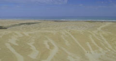 Aerial flying over the tepaki sand dunes in Northland, New Zealand Stock Footage