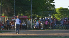 Coed softball at annual small town summer celebration Stock Footage