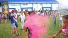 The girl is sprinkled with coloured powder Stock Footage