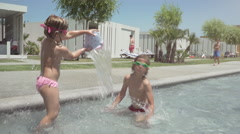 Happy child playing and splashing in a resort Stock Footage